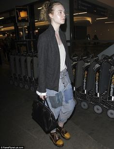 Stylish chic: Elle Fanning rocked a laid-back look as she arrived at LAX on Friday. The Ma...