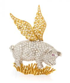 An 18 Karat Gold, Diamond and Sapphire Flying Pig Brooch, consisting of a white gold body accented with yellow gold wings and grassy wirework base, the body and wings containing numerous round brilliant cut diamonds weighing approximately 2.25 carats total and two round mixed cut pink sapphire eyes. Stamp: 18K AL PA.