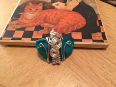 $23.00 Turquoise half shell wire wrap pendant.