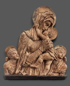 Virgin and child with two angels. Italian (Padua). Bartolomeo Bellano, About 1460–70. 78.7 x 67.3 x 11.4 cm . Terracotta with traces of polychromy Classification: Sculpture.