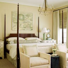 Sleep in Style: A traditional wooden four-poster bed establishes the master suite as the most formal bedroom in the home, while coastal accents like a sea grass rug and bamboo-shaped lamp keep it from being overly so.    Wonder Wall: Grasscloth walls provide just enough textural interest without being distracting.