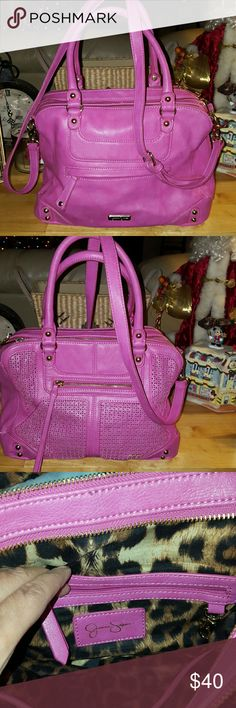 Jessica Simpson purse Gently used Jessica Simpson purse in great condition.  It does have a tear in back bottom right and a stain on bottom part of purse.  Purse has a long strap it can be used as a crossbody. Jessica Simpson Bags Satchels