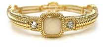Zirconmania - Cubic Zirconia Fine Jewelry Classic Textured Satin Electroplate Stretch Bangle with 4-faceted Cushion Square stone stations.