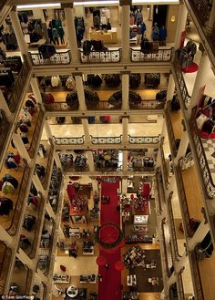 Holiday decorations adorn the Marshall Field Building in Macy's State Street, Chicago while the ant-like shoppers fill the floors below