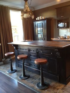 Lynn's black distressed island. It was originally an old store counter.  we refaced the back of the cabinet by ripping apart another cabinet so both sides look finished.  love the stools.
