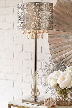 Lighting is an artful endeavor, especially in the case of Pier 1's Bohemian Crystal Lamp. Influenced by modern Bohemian styling, our gleaming, metallic lamp features a punched floral pattern and warm amber crystal beads and drops.