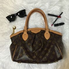 """Authentic Louis Vuitton Tivoli PM Bought this but never used much & it has been kept in dust bag. Conditions are like new & handles hasn't changed color. Comes with Paper bag & dust bag. 14.17""""x8.27""""x6.3"""". Louis Vuitton Bags Satchels"""