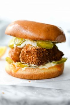 If you think that making a healthier fish fillet sandwich at home is an impossible task, think again. This fried fish sandwich with homemade tartar sauce is golden brown and ready to serve in under 30 minutes, and it's so good that it puts McDonald's filet-o-fish to shame.| foodiecrush.com #fish #sandwich #healthy #fried