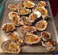 garlic parmesan baked oysters - We made these at home but on the grill. Delicious, but very time consuming when you have to open the oysters yourself.   A.P.