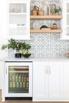 Have fun with tile! A wet bar is a prime opportunity to get playful with your backsplash. The small surface area means you can experiment with color, pattern, or texture , turning your bar from household utility to design statement. Kitchen Tiles Design, Kitchen Wall Tiles, Kitchen Backsplash, Mosaic Backsplash, Mosaic Tiles, Kitchen Mosaic, Backsplash Ideas, White Shaker Kitchen Cabinets, Farmhouse Kitchen Cabinets