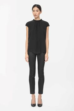 Designed to drape softly on the body, this top has a padded round neckline. Made from layers of sheer fabric with raw-cut edges, it has soft front pleats, cap sleeves and a hidden zip fastening on the back.