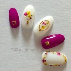 White and fuschia polish with yellow and fuschia dried flowers, gold accent nail art.