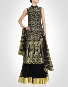 Lehenga with a black backdrop and gold accents. Shop Now: www.kimaya.in