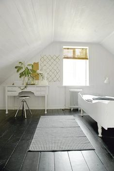 scandinavian cottage bedroom, black floor white walls. Photo Katarina Grip Höök