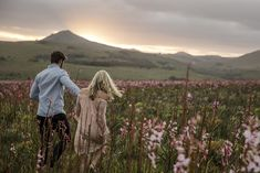 couple shoot photography field flowers hills mountains sunset Mountain Sunset, Couple Shoot, Couple Photography, Africa, Mountains, Couples, Flowers, Wedding, Travel