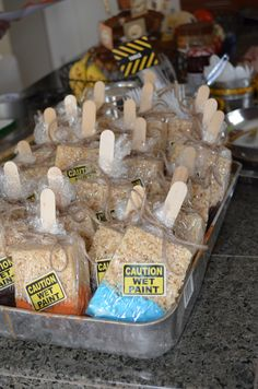 Construction party take-home treat…paint brush Rice Krispie treat.