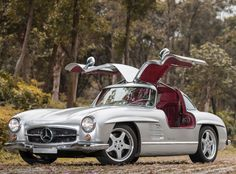 1954 Mercedes Benz #300SL #Gullwing. EPIC! AMG took 11 original 300SLs - eight coupes and three roadsters - and did a restomod on them. Seen on: http://www.motorauthority.com/news/1090910_one-of-eleven-amg-modded-mercedes-benz-300sls-up-for-sale#image=100460869