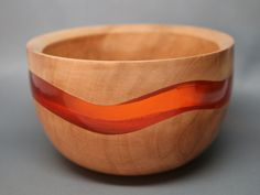 Leroy Coleman, Jr. | Colemancraft | A collectible handcrafted wooden bowl turned and carved from Western Figured Maple wood, and exquisitely colored clear resin orange inlay.