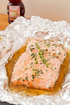 BAKED SALMON WITH HONEY AND THYME½ tablespoons honey -   2 cloves garlic (minced) -   ½ tablespoon olive oil, plus more -   ¾ tablespoon white wine vinegar -   ½ tablespoon fresh thyme leaves (roughly chopped) -   1 pound salmon with skin -   salt -   ground black pepper