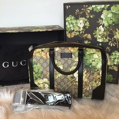 Floral print Gucci top handle bag Brand new authentic Gucci top handle bag. Floral green print with brown and white colors. Comes with a thick strap. Smooth brown suede inside. Also includes dust bag and adorable floral box. Retails for $1750.. looking to get $1400!! - I will meet locally . Stunning bag  very unique Gucci Bags