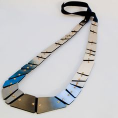Manuela Gandini  Necklace: Nastro 2012  Stainless steel, brass, leather
