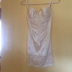 Never worn vintage Victoria's Secret shaping Slip New without tags, vintage Victoria's Secret Shaping Bra slip. Underwire Bra size is 34C. Straps are convertible. Rubberized strip on inside of lace to help keep slip in place. Color is cream with cream colored lace hemline. Size 34C Never worn. Victoria's Secret Intimates & Sleepwear Shapewear
