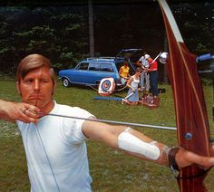 Archery Opel Kadett 1972 calendar - Opel Kadett Caravan  Now, no jokes please about this guy's expression. Archery is a serious sport. However, I only see it at the Olympics. It is also a sport preferred by nudists in their resorts, so I'm told - but I have no experience there. That are a lot of people and a lot of gear to stow in that Kadett, by the way.  Location: Wiesbaden-Klarenthal, Germany.