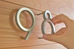 Architects Rick and Brandy McLain of Tuscon, Arizona started Modern House Numbers over a year ago while renovating their home, after facing the challenge of finding affordable modern home address numbers for the front of homes, mailboxes and front curb. They decided to design their own and soon afterwards others were asking about their modern address solution.