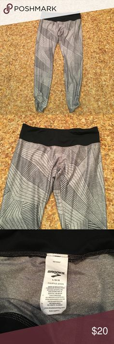 Brooks athletic pants Sz L Like new... cant tell hey have ever before been worn... gray/black design... ruching at bottom of legs... 2 inside hidden pocket compartments...Sz L...poly/spandex... athletic pants... beautiful design... Brooks Pants Leggings