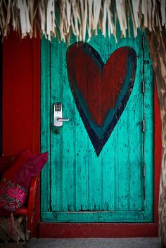 SHOT 1/25/10 6:05:19 PM - An artistically painted door in Sayulita, Mexico. Sayulita is a small surfing and fishing village about 25 miles north of downtown Puerto Vallarta in the state of Nayarit, Mexico, with a population of approximately 4,000. Known for its consistent river mouth surf break, roving surfers discovered Sayulita in the late 60s with the construction of Mexican Highway 200. In recent years, it has become increasingly popular as a holiday and vacation destination, especially…
