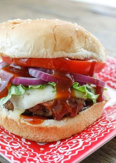 The Filthy Burger is made with Barbecue Pulled Pork, Beef, and Bacon! get the recipe at barefeetinthekitchen.com