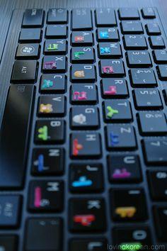 Cute Korean alphabet bear stickers on dark keyboard