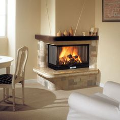 Edilkamin - Fireplaces, wood and pellet burning stoves, fireplace heating systems, thermo-stoves, pellets Floating Fireplace Mantel, Corner Stone Fireplace, Fireplace Trim, Fireplace Update, Fireplace Remodel, Fireplace Surrounds, Fireplace Mantels, Indoor Outdoor Fireplaces, Outdoor Fireplace Designs