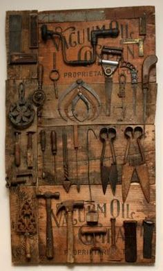 Great idea for displaying antique tools - Love this!  Great idea as I continue to add to his collection!