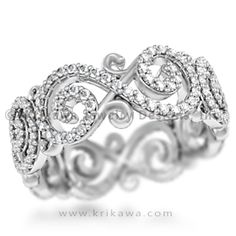 Carved Infinity Pave Wedding Band - We took our Ornate Infinity Wedding Band and upgraded it with micro-paved diamonds! 7.5mm wide.