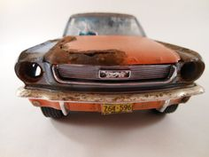 1964 Ford Mustang 1/24 scale model car in blue via Etsy. Miniature car rusting. Automobile wreck
