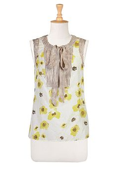 Florals, dots and stripes come together in our silk print block blouse with long ties at the drawstring neck.