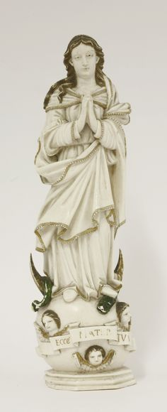 An ivory figure of Madonna,  late 19th century, standing with hands held in prayer Sold for £2500 on 8th December 2015
