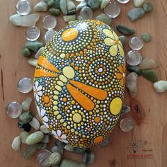 FREE SHIPPING! Hand Painted River Rock - yellow shades of orange collection #37 Large Stone - 6 X 4 X 1.25 - 37 ounces Mandala Inspired Design - Dragonfly Motif - Natural Home Decor Garden Art - Weather Resistant Lacquer Finish As in nature no two ethereal & earth stones are alike. Each stone and its design is unique. I work with each stones shape, size, and texture to create a singular mix of art & nature. This brightly colored hand painted river rock adds a pop of color and cheer to any…