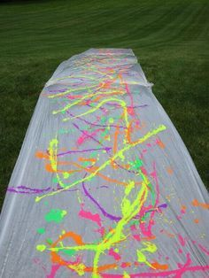 Slip and slide with trash bags! Have everyone wear white!