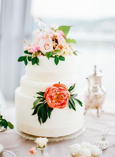 Top your wedding cake with vibrant blooms: http://www.stylemepretty.com/2015/08/09/15-ways-to-dress-up-your-wedding-cake/