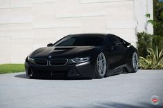 The owner of this BMW i8 decided to take his hybrid sportscar to a whole new level with new wheels, matte black wrap and air suspension