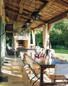 Isn't this what we picture our lives to be like if we moved to France? Designed by Ginny Magher in Provence. #fireplace