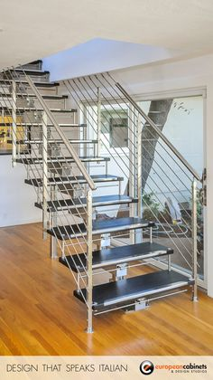 Solid wood steps with stainless steel edge guards float on a stainless steel stringer.