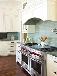 Blue Subway Tile Backsplash - love this whole look - white cabinets, darker floor, stainless, dark handles.