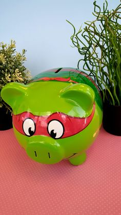 This TMNT Raphael piggy bank is too CUTE!
