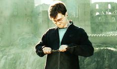"""Harry snapping the Elder Wand in half. 