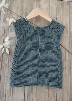 This listing is for the PDF of the knitting pattern ONLY, AND NOT THE FINISHED ITEM. Lil' Rosebud seamless top down dress / tunic top This seamless little top down dress / tunic top is an easy knit, worked in garter stitch with a simple leaf pattern forming the front borders, then