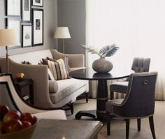 Lovely gray walls with a light colored couch and darker accent chairs