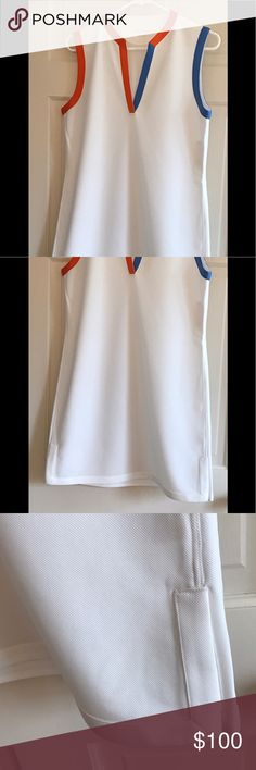 """Tory Sport Sleeveless Tunic Dress Size L Tory Sport dress. For tennis, golf, errands. Unlined. V-neck trimmed in light blue and orange, as are the arms. 4 1/2"""" slits on sides. Polyester pique. Length about 34"""". Arm openings about 8"""". Across the bust about 19 1/2"""". Across the middle about 18 1/2"""". Tory Burch Dresses"""